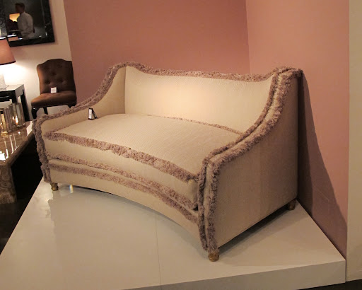 The trim on this sofa is so inviting; the feet are hand carved in gilt wood.