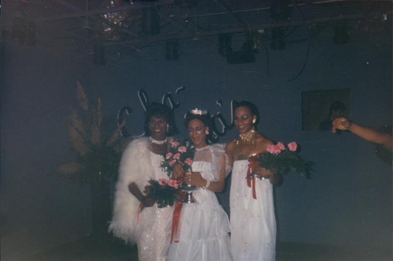 Three drag queens in white at a pageant fundraiser. October 1984.