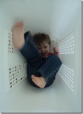 feet moving in laundry basket