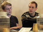 A photo of two people hudling over a laptop discussing something substantial