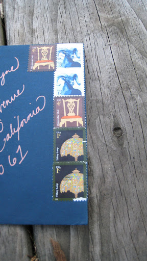 A collection of postage stamps and Melissa's handwritten addresses decked the fronts of the envelopes.