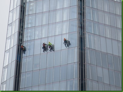 050  Closeup of window cleaners on the 'Shard', 300 ft above ground