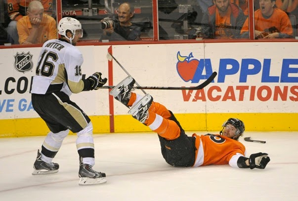 Oct 17, 2013; Philadelphia, PA, USA; Philadelphia Flyers right wing Jakub Voracek (93) is checked by Pittsburgh Penguins center Brandon Sutter (16) during the third period at Wells Fargo Center. The Penguins defeated the Flyers, 4-1. Mandatory Credit: Eric Hartline-USA TODAY Sports