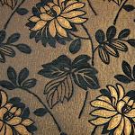 Tkanina obiciowa z efektem metalicznym w kwiaty. Brązowa, miedziana.