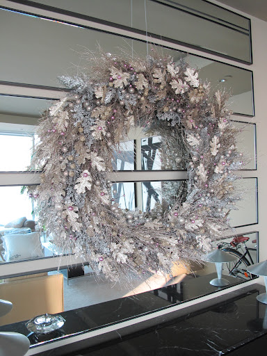 I made the wreath using a 36-inch wire form, from U.S. Evergreens Inc. (usevergreens.com), and shimmery, silver garland from Jamali Garden (jamaligarden.com).