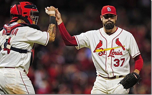 Sep 13, 2014; St. Louis, MO, USA; St. Louis Cardinals relief pitcher Pat Neshek (37) celebrates with catcher Yadier Molina (4) after defeating the Colorado Rockies 5-4 at Busch Stadium. Mandatory Credit: Jeff Curry-USA TODAY Sports