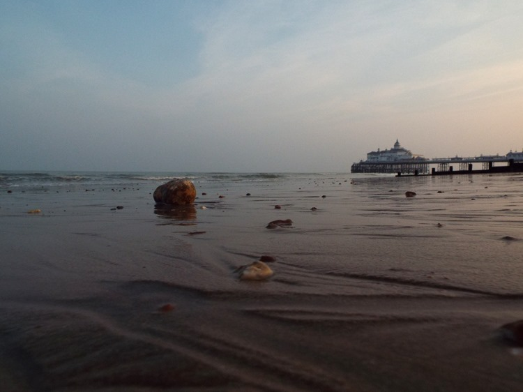 Eastbourne pier, low tide, dusk