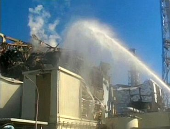 A fire truck sprays water at No 3 reactor of the Fukushima Daiichi nuclear power plant in Tomioka, Fukushima prefecture in this still image taken from a video by the Self Defence Force Nuclear Biological Chemical Weapon Defence Unit