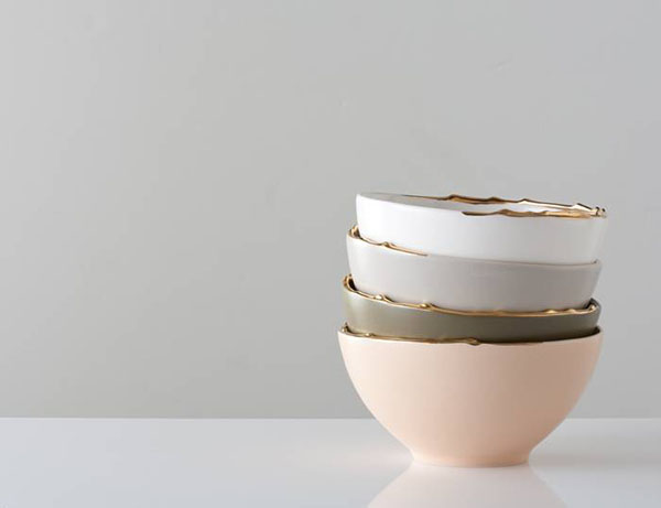 Flawed gold plated set of bowls  2