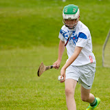 Rúairí Meighan about to strike an sliotar