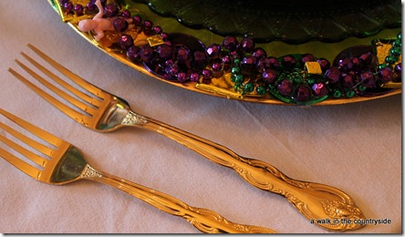 gold flatware for mardi gras table