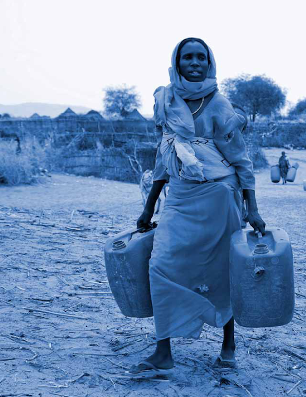 A woman carries jugs for hauling water. 'The Global Water Crisis: Addressing an Urgent Security Issue', InterAction Council, 2012