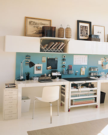 It can be a challenge to create a desk that's roomy enough for one person, let alone two. This symmetrical setup is the perfect solution, unifying a pair of workstations in an open configuration that fits snugly against almost any stretch of wall without overwhelming the rest of the room.