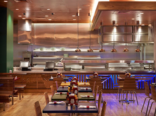 The primary colors and open kitchen of Burgers and More create a casual and family friendly environment.