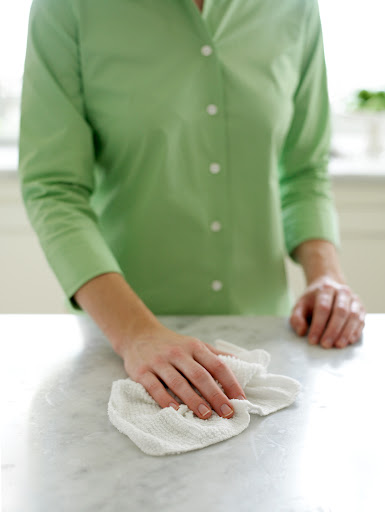 Bar mop cloths are better than paper towels.  More absorbent and reusable.