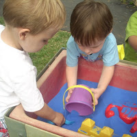 Toddlers Enjoying The Sand Table 7.12.12