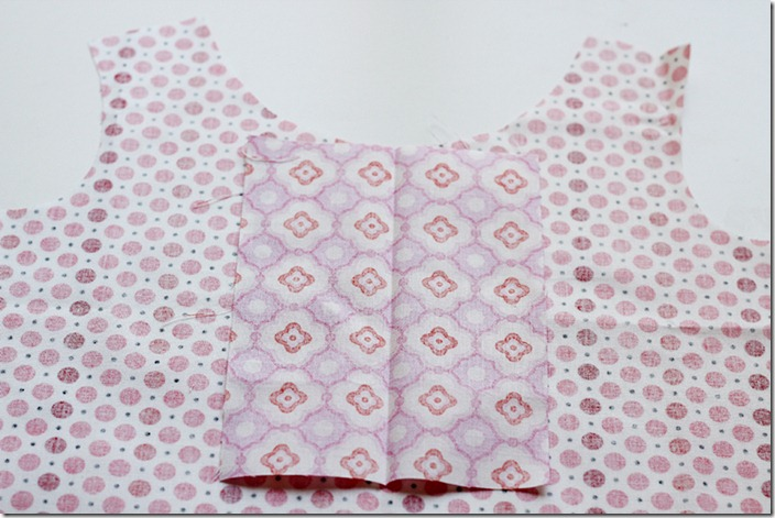 Placket face down on bodice