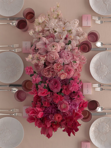 Different shades of red and pink flowers make up this arrangement. (Martha Stewart Weddings)
