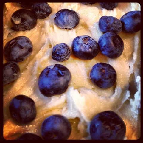 Blueberry loaf cake being layered