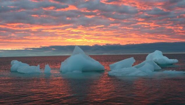 In this September 2006 file photo, ice chunks float in the Arctic Ocean as the sun sets near Barrow, Alaska. Photo: AP