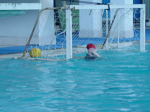 I see nothing. Goalie wipes eyes after the ball goes to the back of the net.