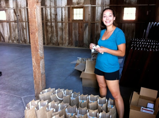 Alyssa readies the welcome bags.