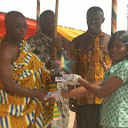 Nana Kodua Kesseh, presenting an award to one of the school..JPG