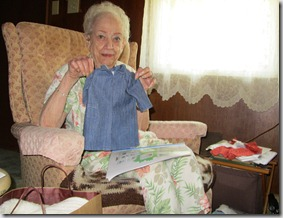 Aunt Peg with one of her doll clothing coats.
