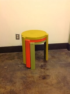 Set of 3 plastic stacking tables in yellow, orange, and green