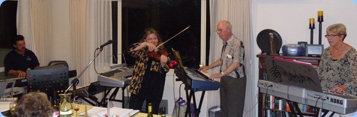 Peter Littlejohn (left) joining in the fun with Marian Burns, Peter Brophy and Jan Johnston (right) jamming