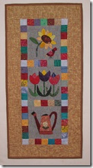 Dad's quilts appliqued garden