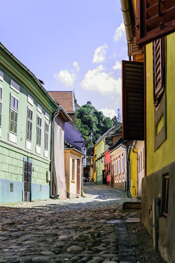 Medieval Street in Color by Andreea Alexe - Buildings & Architecture Public & Historical ( clouds, narrow, houses, colorful, color, blue, architecture, medieval,  )
