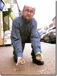 Paul Bartlett picks up cigarette butts in Stony Stratford     
