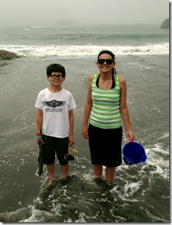 Jack and Katie standing in poopy water