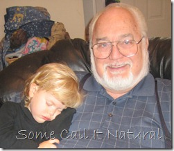 Here he is with one of grandkids.  He's a happyy Grandpa!