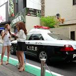 Tokyo Police driving by at Campus Summit 2013 by Matt van Vuuren in Shibuya, Tokyo, Japan