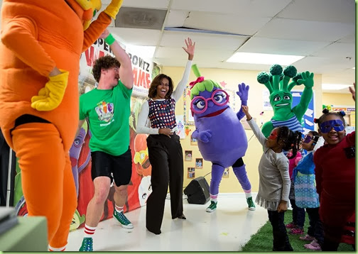 "First Lady Michelle Obama joins children for a Super Sprowtz show, a ""Let's Move!"" event at La Petite Academy child care center in Bowie, Md., Feb. 27, 2014. (Official White House Photo by Chuck Kennedy)"
