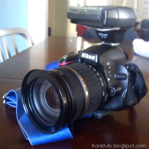 my Nikon D5100 with Tamron 18-200mm lens, 77mm step up ring, and SB400 flash