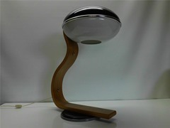 Table or desk lamp in bent wood with an acrylic saucer shaped diffuser