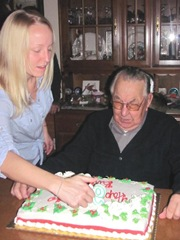 12.10.2011 dads 93rd bday kelly lighting candles on cake with dad