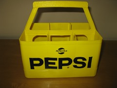 Vintage Pepsi-Cola bottle holder in yellow
