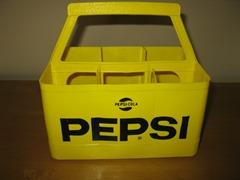 Vintage Pepsi-Cola bottle holder in yellow