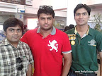 Reader Manali Doshi&#039;s friends Monil Gosalia (in checks shirt), Jatin Jajodia (in green t-shirt) with R Madhavan [ Images ] at Mumbai airport.