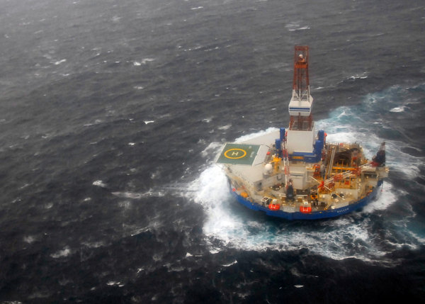 The Kulluk drill barge as it was being towed Sunday south of Kodiak Island in Alaska, 30 December 2012. Heavt seas forced crew members to disconnect the rig from its last remaining tow line and the vessel went aground on a small island south of Kodiak on 1 January 2012. U.S. Coast Guard
