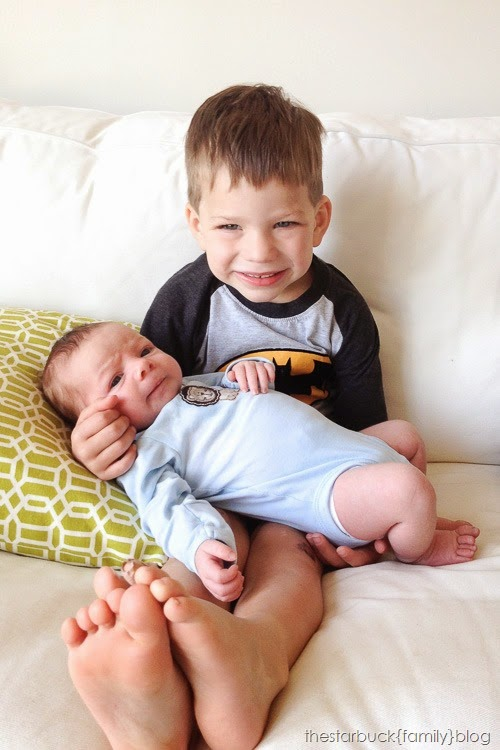 Ryan holding Ethan in playroom blog-2