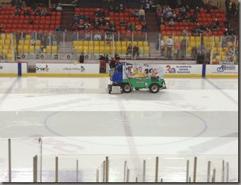 a zamboni wetting the ice rink down