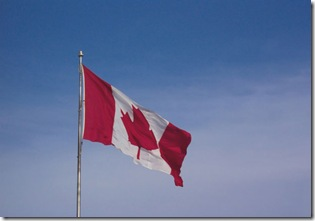 canadian-flag-blowing-in-the-wind-23441288987691KnC