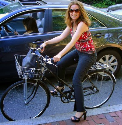 lady rides bike.jpg