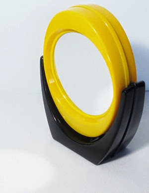 yellow and black swiveling vanity magnifying mirror back