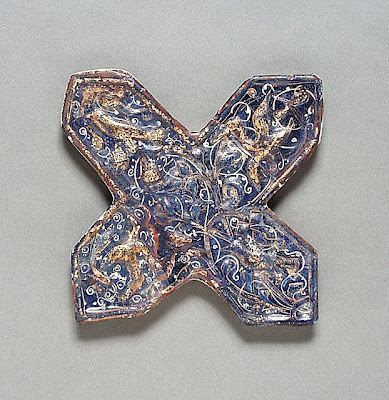 Cross Tile | Origin: Iran | Period:  late 13th century | Collection: Shinji Shumeikai Acquisition Fund (AC1996.115.5) | Type: Ceramic; Architectural element, Fritware, molded, overglaze painted and gilded, lajvardina, Maximum height: 9 3/4 in. (24.8 cm)